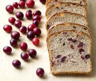 Bread with cranberries on a wooden board Stock Photography