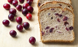 Bread with cranberries on a wooden board Stock Images