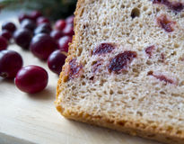 Bread with cranberries on a wooden board Stock Image