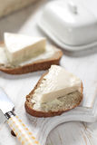 Bread with cream cheese. Slice of bread with cream cheese for breakfast Royalty Free Stock Photos