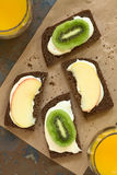 Bread with Cream Cheese and Fruit Slices Stock Photography