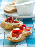 Bread with cream-cheese and paprika Stock Images