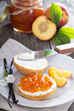 Bread with cream cheese and peach jam Royalty Free Stock Image