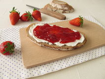 Bread with cream cheese and strawberry jam Royalty Free Stock Image