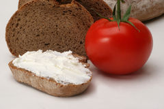 Bread with cream cheese. And tomato Royalty Free Stock Photos