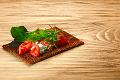 Bread crisp with tomato, cheese and arugula Royalty Free Stock Photo