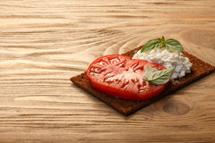 Bread crisp with tomato, cheese and basil Royalty Free Stock Images