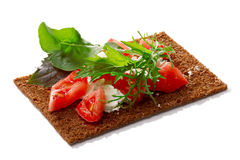 Bread crisp with tomato, soft cheese and greens Royalty Free Stock Images