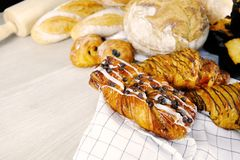 Bread, Croissant, Muffin Chocolate Bakery Party Breakfast at home. Cooking food with Rolling Pin on Wooden Background. Relax Hobby. Image royalty free stock images