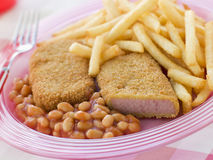 Bread crumbed Luncheon Meat with Baked Beans. And Chips Royalty Free Stock Image