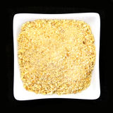 Bread crumbs in a glass bowl. On black background Royalty Free Stock Photos