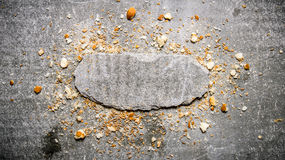 Bread crumbs and a stone stand.  Free space for text . Royalty Free Stock Images
