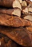 Bread crust background. Fresh Italian ciabatta cut bread and crust background stock image