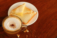 Bread and a cup of delicious coffee. A Bread and a cup of delicious coffee Stock Image