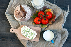 Bread with curd, cheese, chive and tomato Stock Photos
