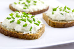 Bread with curd cheese and chives. Brown bread with curd cheese and chives Royalty Free Stock Images