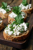 Bread with curd cheese and herbs Stock Photo