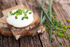 Bread with curd and chive Stock Photos