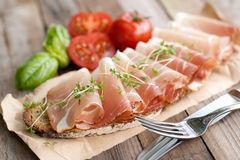 Bread with cured ham Stock Photography