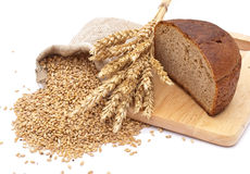 Bread cut on a board. A bag with wheat and ear of the wheat Royalty Free Stock Photo