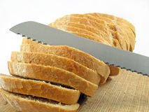 Bread cut and knife Stock Photos