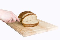 Bread cut by knife on kitchen board Stock Photos