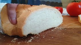 Bread cut crust with a knife bakery on a wooden. Bread cut with a knife on a wooden crust bakery stock video footage