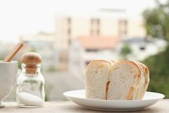 Bread cut in slices on a white plate Royalty Free Stock Photography