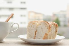 Bread cut in slices on a white plate Royalty Free Stock Photos