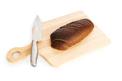 Bread and cutting board Royalty Free Stock Photos