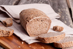 Bread on cutting board Stock Images