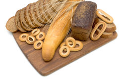 Bread on a cutting board on a white background Stock Image