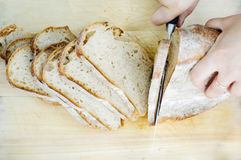 Bread cutting Royalty Free Stock Photo
