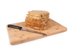 Bread and cutting wood Stock Images