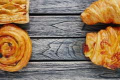 Bread danish and croissant on top view wooden background with empty space, healthy eating Royalty Free Stock Photography