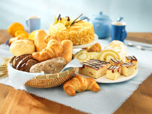 Bread and dessert. Arrangement on table royalty free stock image
