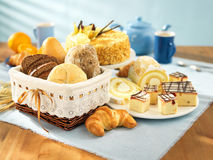 Bread and dessert. Arrangement on table stock photo
