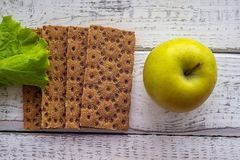 Bread diet for weight loss. The bread diet for weight loss, apples and bread, lettuce, in the background, slimming Stock Photography