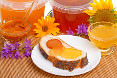 Bread and different types of honey Royalty Free Stock Image
