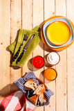 Bread and Dips on Wood Table with Colorful Plates Royalty Free Stock Photos