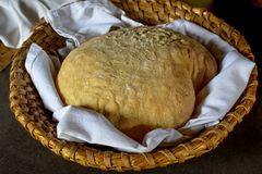 Bread Dough in a Basket. Bread Dough laying in a white napkin inside of a woven basket Royalty Free Stock Photos