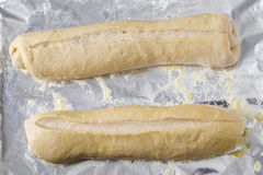 Bread dough batons rising Royalty Free Stock Photo