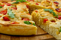Bread dough Focaccia with salad Stock Images