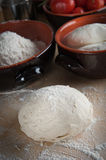 Bread dough, pizza dough. On a pastry board Royalty Free Stock Photography
