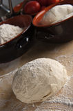 Bread dough, pizza dough. On a pastry board Stock Photography