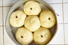 Bread dough on tray. Bread dough arranged on baking tray ready to be baked Stock Photo