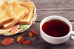 Bread, dried fruit and tea Stock Photos