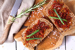 Bread with dried tomatoes and herbs Stock Photography
