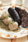 Bread dumplings with blood sausage Stock Photos