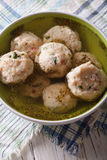 Bread dumplings with broth, close-up  on the table. vertical top Stock Image